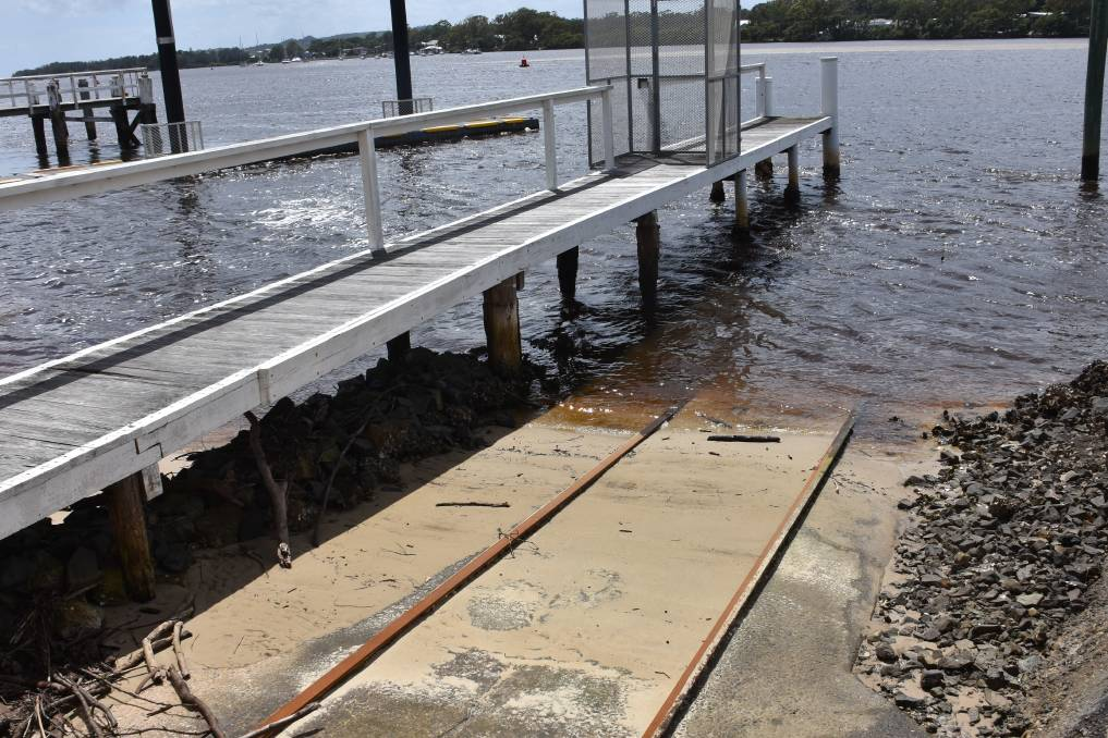 SANDY STOCKPILE: Marine Rescue Camden Haven is asking for assistance to solve a sandy problem blocking their launching ramp.